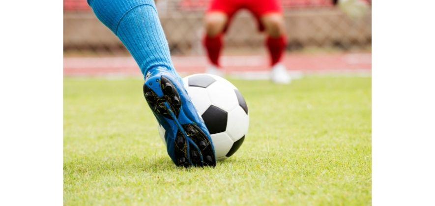 black and white soccer balls - assisted foot placement for players